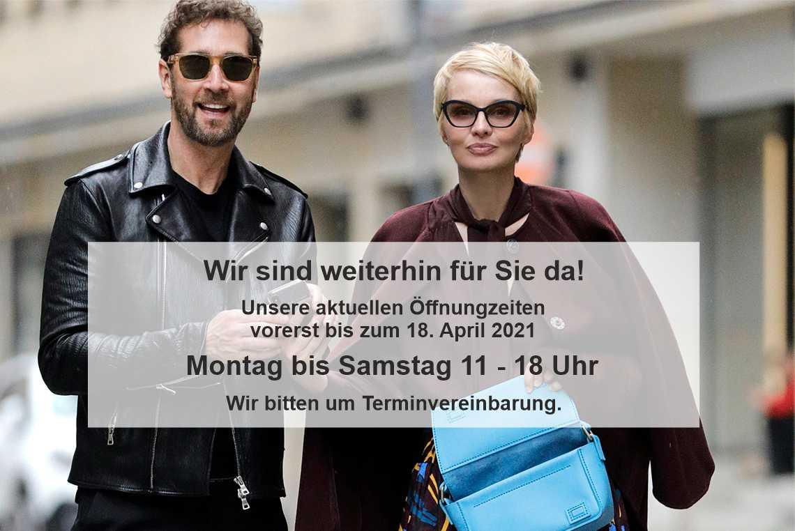 Der Starfriseur Jörg Oppermann und die Moderatorin Susann Atwell mit Sonnenbrillen von BELLEVUE in der Hamburger City.